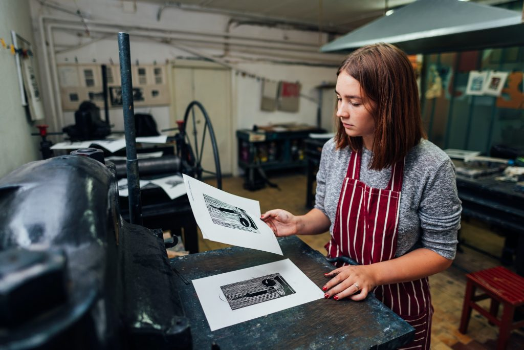 linocut. manual printing on the machine